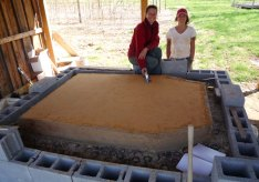 Ashley and Heather, ready to lay some bricks