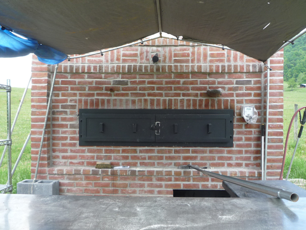 In the center above the outer blast doors is the flue damper, the box to the right is the temperature reader.